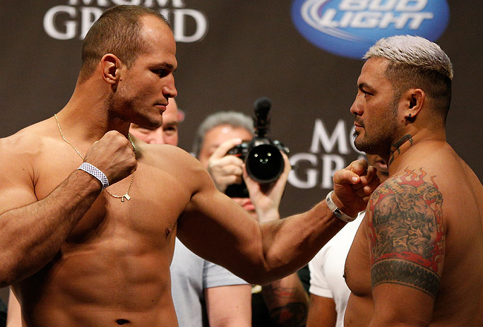 "LAS VEGAS, NV - MAY 24:   (L-R) Opponents Junior ""Cigano"" dos Santos and Mark Hunt face off during the UFC 160 weigh-in at the MGM Grand Garden Arena on May 24, 2013 in Las Vegas, Nevada.  (Photo by Josh Hedges/Zuffa LLC/Zuffa LLC via Getty Images)"