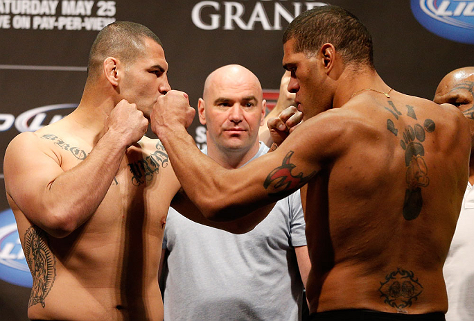 "LAS VEGAS, NV - MAY 24:  (L-R) Opponents Cain Velasquez and Antonio ""Bigfoot"" Silva face off during the UFC 160 weigh-in at the MGM Grand Garden Arena on May 24, 2013 in Las Vegas, Nevada.  (Photo by Josh Hedges/Zuffa LLC/Zuffa LLC via Getty Images)"