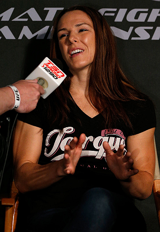 WINNIPEG, CANADA - JUNE 13:  Alexis Davis interacts with media during the UFC 161 media day at The Met on June 13, 2013 in Winnipeg, Manitoba, Canada.  (Photo by Josh Hedges/Zuffa LLC/Zuffa LLC via Getty Images)