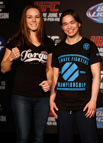 WINNIPEG, CANADA - JUNE 13:  (L-R) Opponents Alexis Davis and Rosi Sexton pose for photos during the UFC 161 media day at The Met on June 13, 2013 in Winnipeg, Manitoba, Canada.  (Photo by Josh Hedges/Zuffa LLC/Zuffa LLC via Getty Images)
