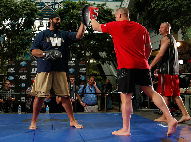 WINNIPEG, CANADA - JUNE 12:  (R-L) Pat Barry works out with former CFL football player Obby Khan during an open workout session for fans and media at Portage Place on June 12, 2013 in Winnipeg, Manitoba, Canada.  (Photo by Josh Hedges/Zuffa LLC/Zuffa LLC