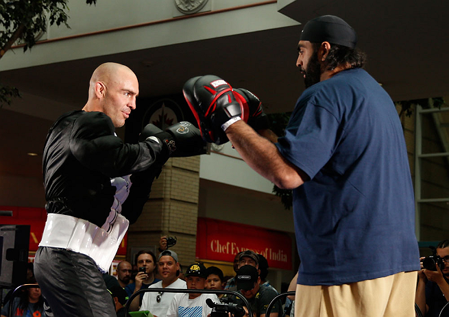 WINNIPEG, CANADA - JUNE 12:  (L-R) Sean Pierson works out with former CFL football player Obby Khan during an open workout session for fans and media at Portage Place on June 12, 2013 in Winnipeg, Manitoba, Canada.  (Photo by Josh Hedges/Zuffa LLC/Zuffa L