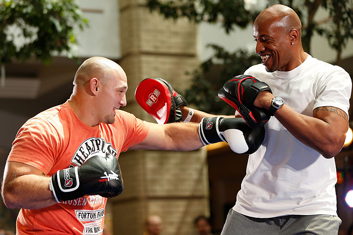 WINNIPEG, CANADA - JUNE 12:  (L-R) Shawn Jordan works out with former CFL football player Lamar McGriggs during an open workout session for fans and media at Portage Place on June 12, 2013 in Winnipeg, Manitoba, Canada.  (Photo by Josh Hedges/Zuffa LLC/Zu