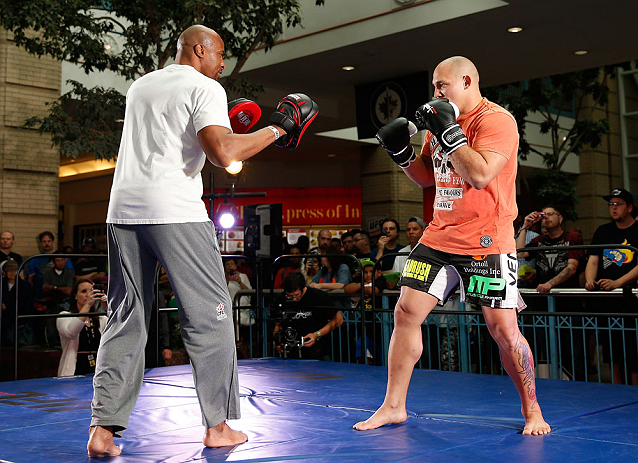 WINNIPEG, CANADA - JUNE 12:  (R-L) Shawn Jordan works out with former CFL football player Lamar McGriggs during an open workout session for fans and media at Portage Place on June 12, 2013 in Winnipeg, Manitoba, Canada.  (Photo by Josh Hedges/Zuffa LLC/Zu