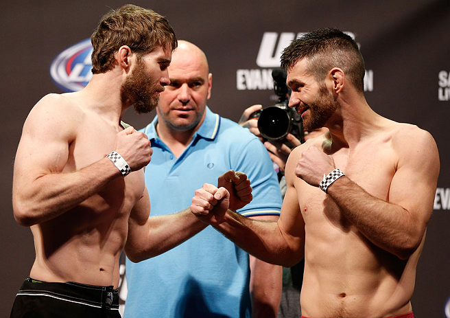 WINNIPEG, CANADA - JUNE 14:  (L-R) Opponents Mitch Clarke and John Maguire face off during the UFC 161 weigh-in at the MTS Centre on June 14, 2013 in Winnipeg, Manitoba, Canada.  (Photo by Josh Hedges/Zuffa LLC/Zuffa LLC via Getty Images)