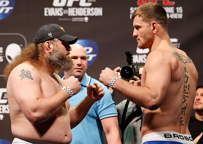 """WINNIPEG, CANADA - JUNE 14:  (L-R) Opponents """"Big Country"""" Roy Nelson and Stipe Miocic face off during the UFC 161 weigh-in at the MTS Centre on June 14, 2013 in Winnipeg, Manitoba, Canada.  (Photo by Josh Hedges/Zuffa LLC/Zuffa LLC via Getty Images)"""