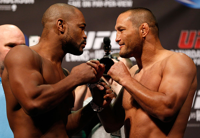 WINNIPEG, CANADA - JUNE 14:  (L-R) Opponents Rashad Evans and Dan Henderson face off during the UFC 161 weigh-in at the MTS Centre on June 14, 2013 in Winnipeg, Manitoba, Canada.  (Photo by Josh Hedges/Zuffa LLC/Zuffa LLC via Getty Images)