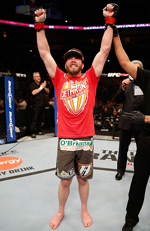 WINNIPEG, CANADA - JUNE 15:  Mitch Clarke reacts after his split decision victory over John Maguire in their lightweight fight during the UFC 161 event at the MTS Centre on June 15, 2013 in Winnipeg, Manitoba, Canada.  (Photo by Josh Hedges/Zuffa LLC/Zuff