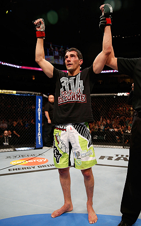 WINNIPEG, CANADA - JUNE 15:  Roland Delorme reacts after defeating Edwin Figueroa in their bantamweight fight during the UFC 161 event at the MTS Centre on June 15, 2013 in Winnipeg, Manitoba, Canada.  (Photo by Josh Hedges/Zuffa LLC/Zuffa LLC via Getty I