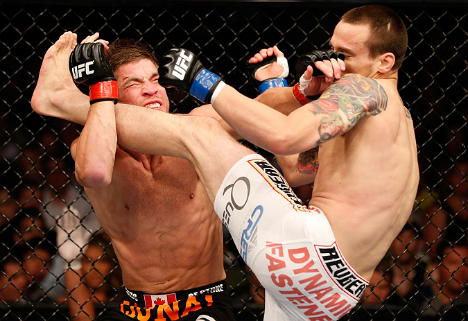 WINNIPEG, CANADA - JUNE 15:  (R-L) James Krause kicks Sam Stout in their lightweight fight during the UFC 161 event at the MTS Centre on June 15, 2013 in Winnipeg, Manitoba, Canada.  (Photo by Josh Hedges/Zuffa LLC/Zuffa LLC via Getty Images)