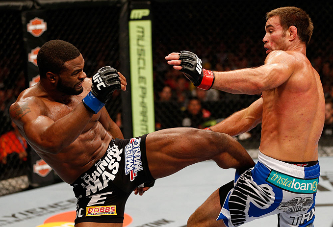 WINNIPEG, CANADA - JUNE 15:  (L-R) Tyron Woodley kicks Jake Shields in their welterweight fight during the UFC 161 event at the MTS Centre on June 15, 2013 in Winnipeg, Manitoba, Canada.  (Photo by Josh Hedges/Zuffa LLC/Zuffa LLC via Getty Images)