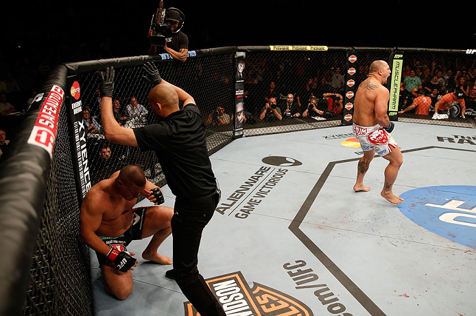 WINNIPEG, CANADA - JUNE 15:  (R-L) Shawn Jordan reacts after knocking out Pat Barry in their heavyweight fight during the UFC 161 event at the MTS Centre on June 15, 2013 in Winnipeg, Manitoba, Canada.  (Photo by Josh Hedges/Zuffa LLC/Zuffa LLC via Getty