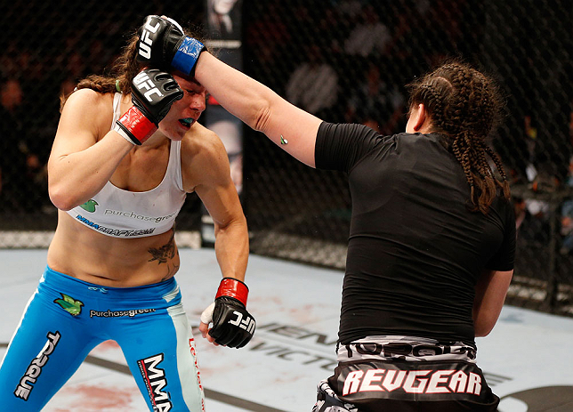 WINNIPEG, CANADA - JUNE 15:  (R-L) Rosi Sexton punches Alexis Davis in their bantamweight fight during the UFC 161 event at the MTS Centre on June 15, 2013 in Winnipeg, Manitoba, Canada.  (Photo by Josh Hedges/Zuffa LLC/Zuffa LLC via Getty Images)