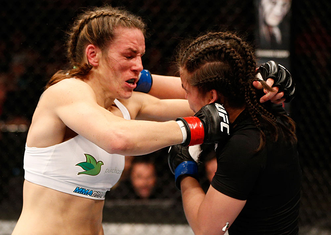WINNIPEG, CANADA - JUNE 15:  (L-R) Alexis Davis and Rosi Sexton trade punches in their bantamweight fight during the UFC 161 event at the MTS Centre on June 15, 2013 in Winnipeg, Manitoba, Canada.  (Photo by Josh Hedges/Zuffa LLC/Zuffa LLC via Getty Image