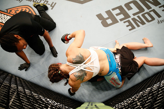 WINNIPEG, CANADA - JUNE 15:  Alexis Davis punches down at Rosi Sexton in their bantamweight fight during the UFC 161 event at the MTS Centre on June 15, 2013 in Winnipeg, Manitoba, Canada.  (Photo by Josh Hedges/Zuffa LLC/Zuffa LLC via Getty Images)