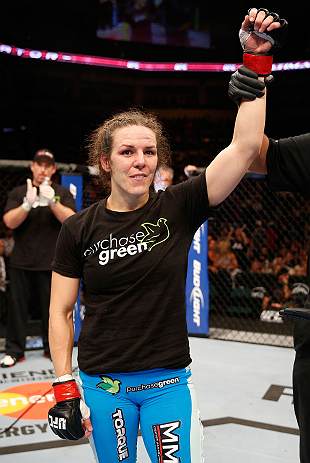 WINNIPEG, CANADA - JUNE 15:  Alexis Davis reacts after defeating Rosi Sexton in their bantamweight fight during the UFC 161 event at the MTS Centre on June 15, 2013 in Winnipeg, Manitoba, Canada.  (Photo by Josh Hedges/Zuffa LLC/Zuffa LLC via Getty Images