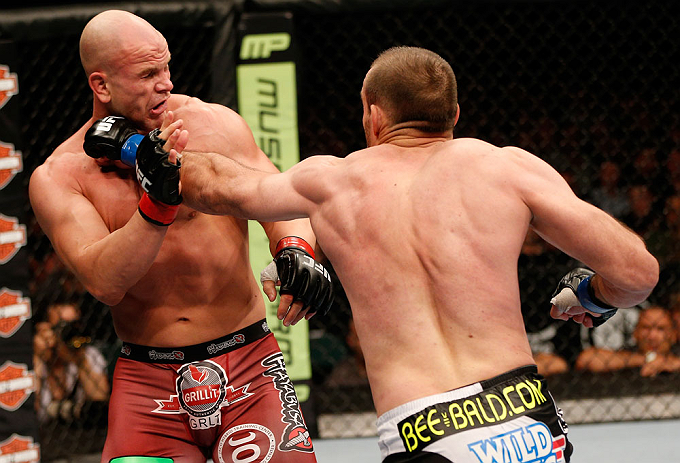 WINNIPEG, CANADA - JUNE 15:  (R-L) Igor Pokrajac punches Ryan Jimmo in their light heavyweight fight during the UFC 161 event at the MTS Centre on June 15, 2013 in Winnipeg, Manitoba, Canada.  (Photo by Josh Hedges/Zuffa LLC/Zuffa LLC via Getty Images)