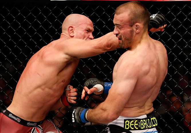 WINNIPEG, CANADA - JUNE 15:  (L-R) Ryan Jimmo punches Igor Pokrajac in their light heavyweight fight during the UFC 161 event at the MTS Centre on June 15, 2013 in Winnipeg, Manitoba, Canada.  (Photo by Josh Hedges/Zuffa LLC/Zuffa LLC via Getty Images)