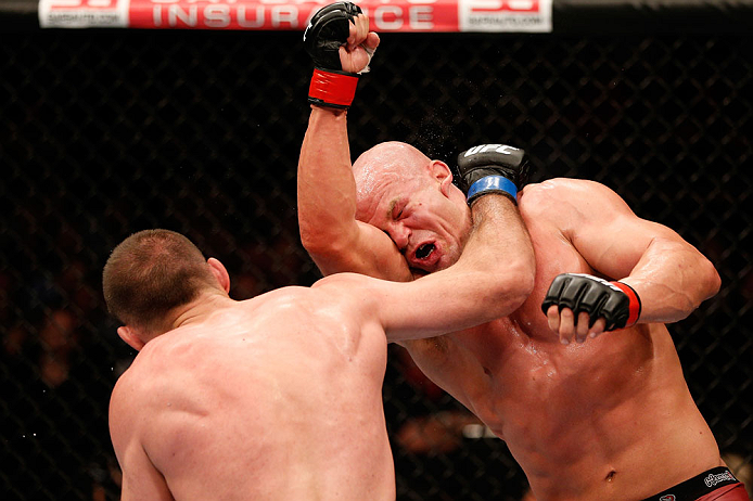 WINNIPEG, CANADA - JUNE 15:  (L-R) Igor Pokrajac punches Ryan Jimmo in their light heavyweight fight during the UFC 161 event at the MTS Centre on June 15, 2013 in Winnipeg, Manitoba, Canada.  (Photo by Josh Hedges/Zuffa LLC/Zuffa LLC via Getty Images)