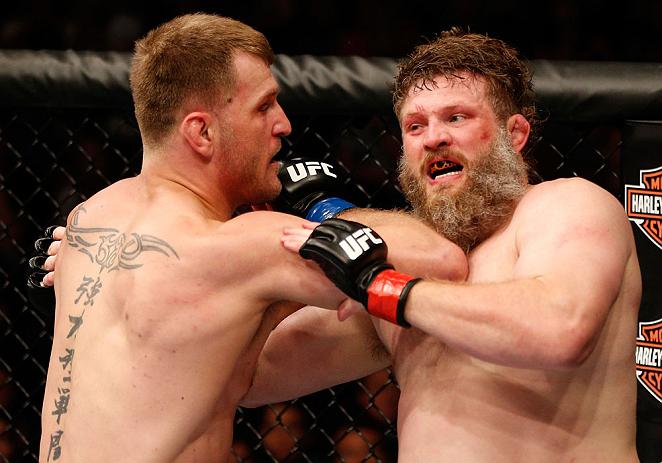 """WINNIPEG, CANADA - JUNE 15:  (L-R) Stipe Miocic elbows """"Big Country"""" Roy Nelson in their heavyweight fight during the UFC 161 event at the MTS Centre on June 15, 2013 in Winnipeg, Manitoba, Canada.  (Photo by Josh Hedges/Zuffa LLC/Zuffa LLC via Getty Imag"""