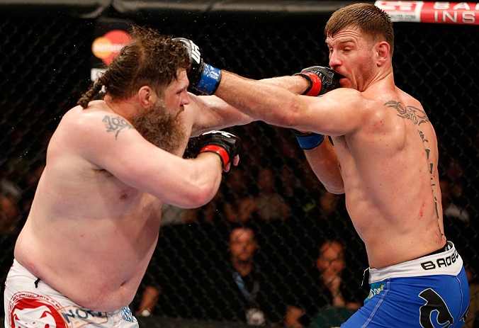 """WINNIPEG, CANADA - JUNE 15:  (L-R) """"Big Country"""" Roy Nelson and Stipe Miocic trade punches in their heavyweight fight during the UFC 161 event at the MTS Centre on June 15, 2013 in Winnipeg, Manitoba, Canada.  (Photo by Josh Hedges/Zuffa LLC/Zuffa LLC via"""