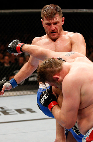 WINNIPEG, CANADA - JUNE 15:  (L-R) Stipe Miocic knees Roy Nelson in their heavyweight fight during the UFC 161 event at the MTS Centre on June 15, 2013 in Winnipeg, Manitoba, Canada.  (Photo by Josh Hedges/Zuffa LLC/Zuffa LLC via Getty Images)