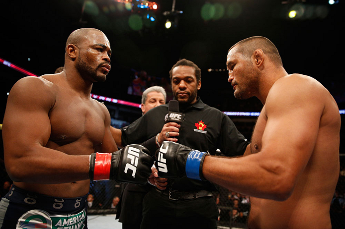 WINNIPEG, CANADA - JUNE 15:  (L-R) Opponents Rashad Evans and Dan Henderson touch gloves before their light heavyweight fight during the UFC 161 event at the MTS Centre on June 15, 2013 in Winnipeg, Manitoba, Canada.  (Photo by Josh Hedges/Zuffa LLC/Zuffa