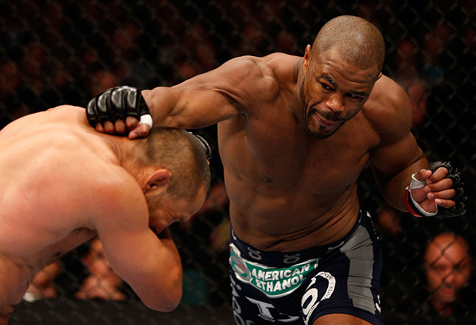 WINNIPEG, CANADA - JUNE 15:  (R-L) Rashad Evans punches Dan Henderson in their light heavyweight fight during the UFC 161 event at the MTS Centre on June 15, 2013 in Winnipeg, Manitoba, Canada.  (Photo by Josh Hedges/Zuffa LLC/Zuffa LLC via Getty Images)