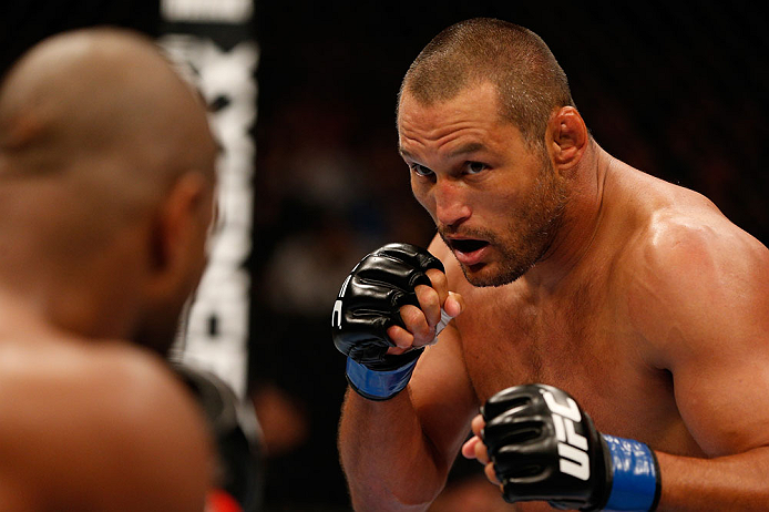 WINNIPEG, CANADA - JUNE 15:  (R-L) Dan Henderson squares off with Rashad Evans in their light heavyweight fight during the UFC 161 event at the MTS Centre on June 15, 2013 in Winnipeg, Manitoba, Canada.  (Photo by Josh Hedges/Zuffa LLC/Zuffa LLC via Getty