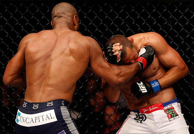 WINNIPEG, CANADA - JUNE 15:  (L-R) Rashad Evans punches Dan Henderson in their light heavyweight fight during the UFC 161 event at the MTS Centre on June 15, 2013 in Winnipeg, Manitoba, Canada.  (Photo by Josh Hedges/Zuffa LLC/Zuffa LLC via Getty Images)