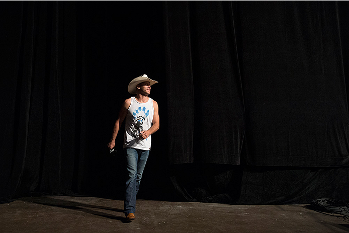 "DALLAS, TX - MARCH 13: Donald ""Cowboy"" Cerrone walks on stage during the UFC 185 weigh-ins at the Kay Bailey Hutchison Convention Center on March 13, 2015 in Dallas, Texas. (Photo by Cooper Neill/Zuffa LLC/Zuffa LLC via Getty Images)"
