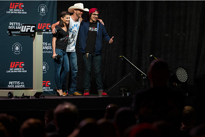 "DALLAS, TX - MARCH 13: Megan Olivi and Donald ""Cowboy"" Cerrone pose for a photo with a fan before the UFC 185 weigh-ins at the Kay Bailey Hutchison Convention Center on March 13, 2015 in Dallas, Texas. (Photo by Cooper Neill/Zuffa LLC/Zuffa LLC via Getty"