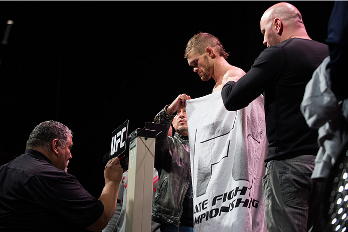 DALLAS, TX - MARCH 13: Daron Cruickshank stands on the scale during the UFC 185 weigh-ins at the Kay Bailey Hutchison Convention Center on March 13, 2015 in Dallas, Texas. (Photo by Cooper Neill/Zuffa LLC/Zuffa LLC via Getty Images)