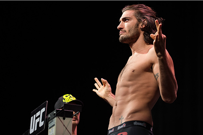 DALLAS, TX - MARCH 13: Elias Theodorou stands on the scale during the UFC 185 weigh-ins at the Kay Bailey Hutchison Convention Center on March 13, 2015 in Dallas, Texas. (Photo by Cooper Neill/Zuffa LLC/Zuffa LLC via Getty Images)
