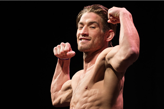 DALLAS, TX - MARCH 13: Sam Stout stands on the scale during the UFC 185 weigh-ins at the Kay Bailey Hutchison Convention Center on March 13, 2015 in Dallas, Texas. (Photo by Cooper Neill/Zuffa LLC/Zuffa LLC via Getty Images)