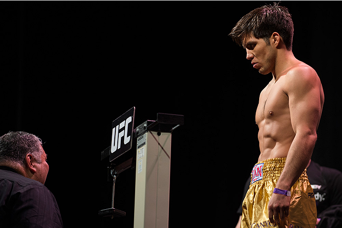 DALLAS, TX - MARCH 13: Henry Cejudo stands on the scale during the UFC 185 weigh-ins at the Kay Bailey Hutchison Convention Center on March 13, 2015 in Dallas, Texas. (Photo by Cooper Neill/Zuffa LLC/Zuffa LLC via Getty Images)