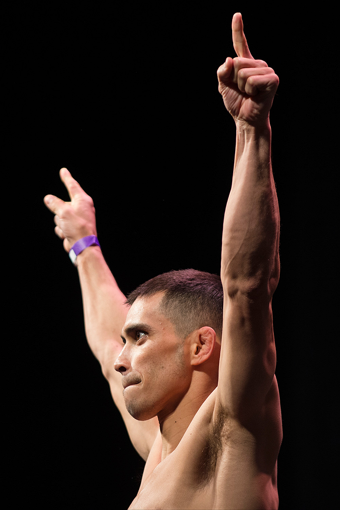 DALLAS, TX - MARCH 13: Chris Cariaso stands on the scale during the UFC 185 weigh-ins at the Kay Bailey Hutchison Convention Center on March 13, 2015 in Dallas, Texas. (Photo by Cooper Neill/Zuffa LLC/Zuffa LLC via Getty Images)