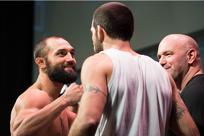 DALLAS, TX - MARCH 13: Johny Hendricks faces off with Matt Brown during the UFC 185 weigh-ins at the Kay Bailey Hutchison Convention Center on March 13, 2015 in Dallas, Texas. (Photo by Cooper Neill/Zuffa LLC/Zuffa LLC via Getty Images)