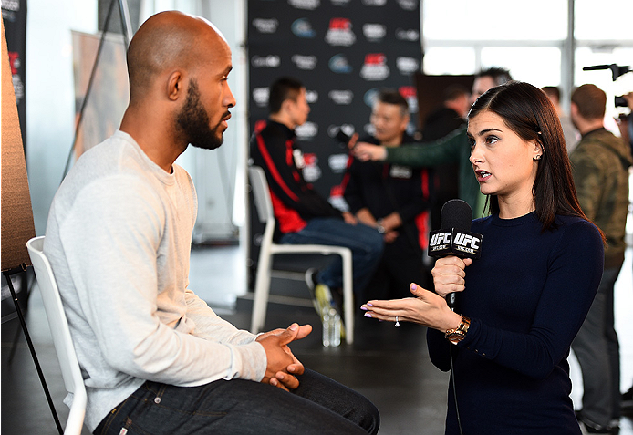 MONTREAL, QC - APRIL 23:  UFC host Megan Olivi interacts with UFC Flyweight Champion Demetrious 'Mighty Mouse' Johnson during the UFC 186 Ultimate Media Day at Scena on April 23, 2015 in Montreal, Quebec, Canada. (Photo by Jeff Bottari/Zuffa LLC/Zuffa LLC