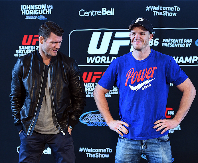 MONTREAL, QC - APRIL 23:  (L-R) Michael Bisping and CB Dollaway face off for the media during the UFC 186 Ultimate Media Day at Scena on April 23, 2015 in Montreal, Quebec, Canada. (Photo by Jeff Bottari/Zuffa LLC/Zuffa LLC via Getty Images)