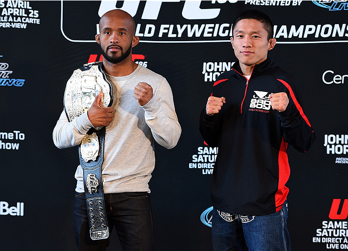 MONTREAL, QC - APRIL 23:  (L-R) UFC Flyweight Champion Demetrious 'Mighty Mouse' Johnson and Kyoji Horiguchi face off for the media during the UFC 186 Ultimate Media Day at Scena on April 23, 2015 in Montreal, Quebec, Canada. (Photo by Jeff Bottari/Zuffa