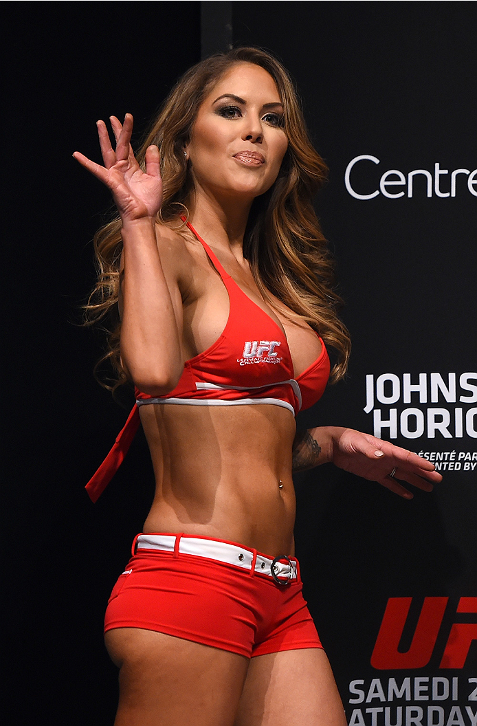 MONTREAL, QC - APRIL 24:   UFC Octagon Girl Brittney Palmer stands on stage during the UFC 186 weigh-in at Metropolis on April 24, 2015 in Montreal, Quebec, Canada. (Photo by Josh Hedges/Zuffa LLC/Zuffa LLC via Getty Images)