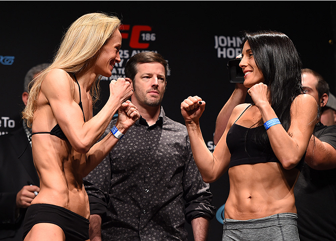 MONTREAL, QC - APRIL 24:   (L-R) Opponents Jessica Rakoczy of the United States and Valerie Letourneau of Canada face off during the UFC 186 weigh-in at Metropolis on April 24, 2015 in Montreal, Quebec, Canada. (Photo by Josh Hedges/Zuffa LLC/Zuffa LLC vi