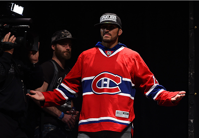 MONTREAL, QC - APRIL 24:   Patrick Cote of Canada prepares to step on the scale during the UFC 186 weigh-in at Metropolis on April 24, 2015 in Montreal, Quebec, Canada. (Photo by Josh Hedges/Zuffa LLC/Zuffa LLC via Getty Images)