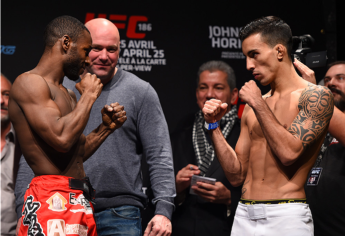 MONTREAL, QC - APRIL 24:   (L-R) Opponents Yves Jabouin of Canada and Thomas Almeida of Brazil face off during the UFC 186 weigh-in at Metropolis on April 24, 2015 in Montreal, Quebec, Canada. (Photo by Josh Hedges/Zuffa LLC/Zuffa LLC via Getty Images)