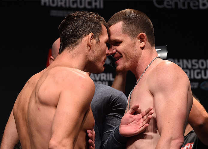 MONTREAL, QC - APRIL 24:   (L-R) Opponents Michael Bisping of England and CB Dolloway of the United States face off during the UFC 186 weigh-in at Metropolis on April 24, 2015 in Montreal, Quebec, Canada. (Photo by Josh Hedges/Zuffa LLC/Zuffa LLC via Gett