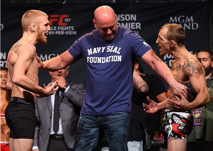 LAS VEGAS, NV - MAY 22:  (L-R) Opponents Justin Scoggins and Joshua Sampo face off during the UFC 187 weigh-in at the MGM Grand Conference Center on May 22, 2015 in Las Vegas, Nevada. (Photo by Josh Hedges/Zuffa LLC/Zuffa LLC via Getty Images)