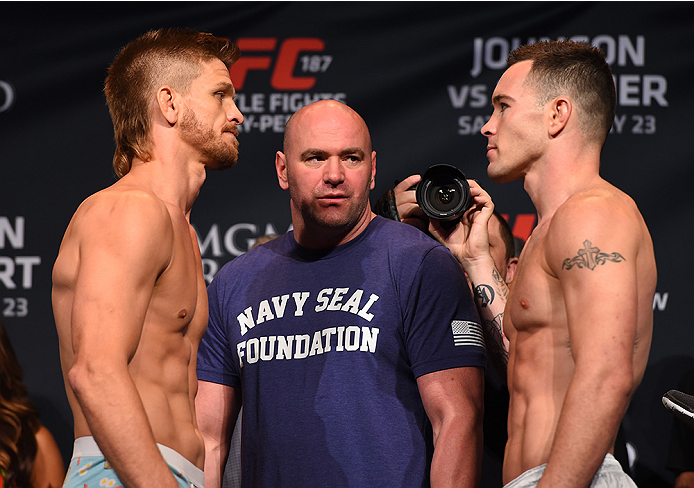 LAS VEGAS, NV - MAY 22:   (L-R) Opponents Mike Pyle and Colby Covington face off during the UFC 187 weigh-in at the MGM Grand Conference Center on May 2, 2015 in Las Vegas, Nevada. (Photo by Josh Hedges/Zuffa LLC/Zuffa LLC via Getty Images)