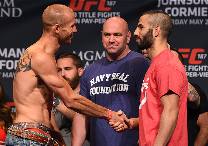 LAS VEGAS, NV - MAY 22:   (L-R) Opponents Donald 'Cowboy' Cerrone and John Makdessi of Canada face off during the UFC 187 weigh-in at the MGM Grand Conference Center on May 2, 2015 in Las Vegas, Nevada. (Photo by Josh Hedges/Zuffa LLC/Zuffa LLC via Getty