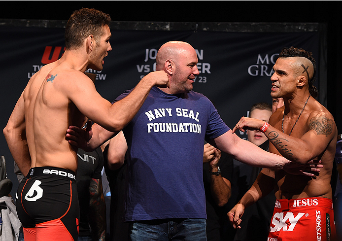 LAS VEGAS, NV - MAY 22:   (L-R) Chris Weidman and Vitor Belfort of Brazil face off during the UFC 187 weigh-in at the MGM Grand Conference Center on May 2, 2015 in Las Vegas, Nevada. (Photo by Josh Hedges/Zuffa LLC/Zuffa LLC via Getty Images)